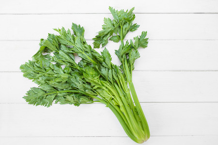 Celery on wooden white table background