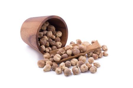 White cardamom seeds in casks on white background
