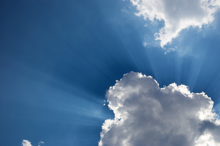 Clouds with blue sky and bright sunny rays