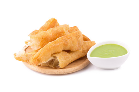 patongkoh: deep fried dough stick and steamed custard on white background.