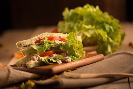 tuna mayo: fresh made Tuna Sandwich on Wooden table