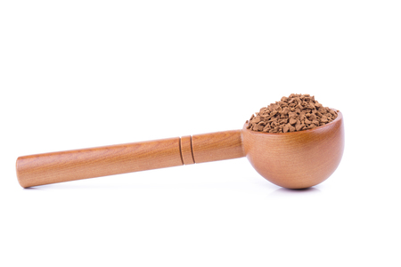 instant coffee, soluble coffee, coffee powder, in Spoon of coffee beans on white background.