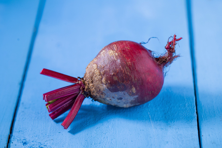 beetroots shooted on blue wooden table.