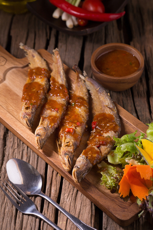 Fried Whisker sheat fish with chili sauce.