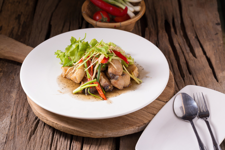 indopacific: Piece of fried King Mackerel fish with fish sauce, served with spicy seafood sauce, thai style.