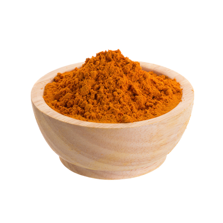 Turmeric powder in wooden bowl on white background. Stock Photo