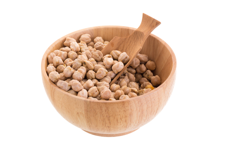 Garbenzo beans on a wooden bowl isolated on a white background.