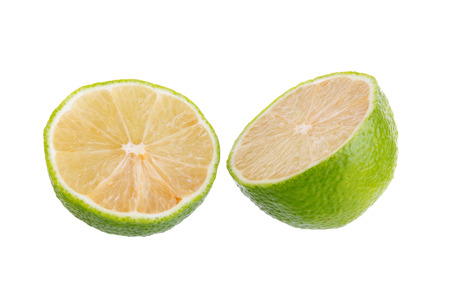 lemon wedge: lime with half cross section isolated on white background. Stock Photo