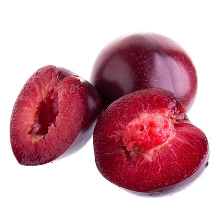 glassy: ripe fresh plum with half and slice isolated on white background. Stock Photo