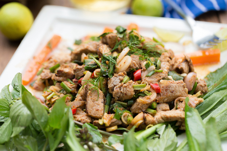 Hot and Spicy Grilled Pork Salad. Thai Beef Salad Recipe. traditionally eaten in Northeast food of Thai flavors. Stock Photo