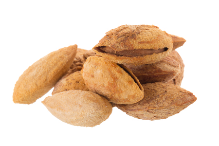 raw: Almond nut in shell isolated on white background. Stock Photo
