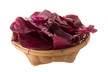 purple potatoes Sliced and fried crisps In the basket isolated on white background.
