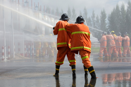 Firefighters spray water in fire extinguishers caused by explosive gas.