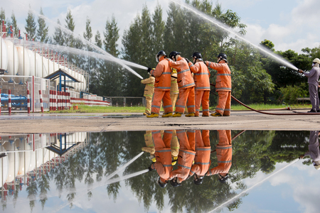 Firefighters spray water in LPG gas tanks, Fire extinguishers caused by explosive gas. Stock Photo