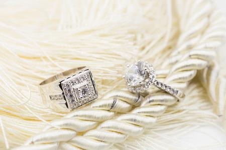 Diamond wedding rings on the white yarns. selective focus.