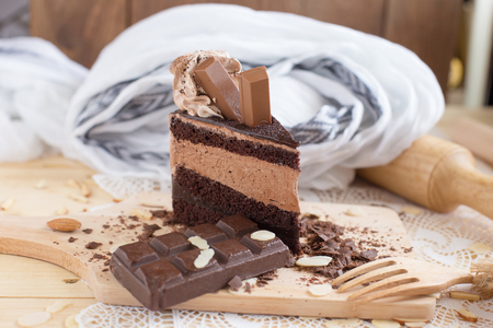 chocolate cake slice with chocolate cream and chocolate bar. cake background concept.