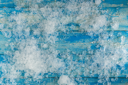 water cooler: Crushed ice cubes on vintage blue wooden table. Top view. Stock Photo
