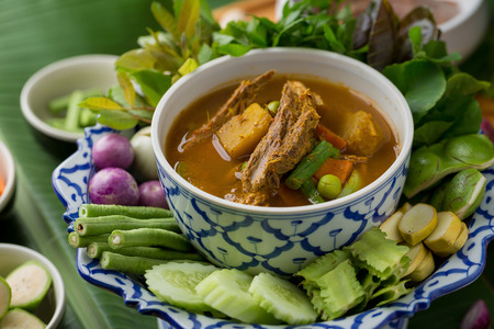 The viscera of mackerel fish paunch hot spicy curry or fish organs sour soup with vegetables, Thai food.