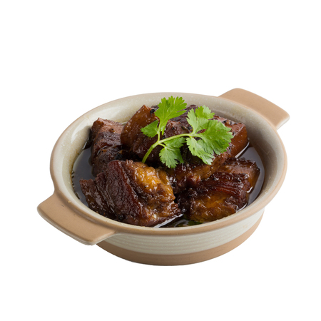 Pork boiled in the sweet gravy isolated on white background.