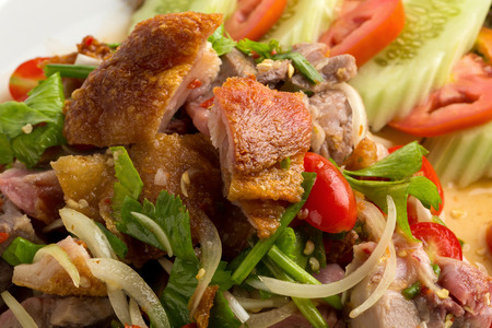 Roasted pork belly spicy salad isolated on white back ground.