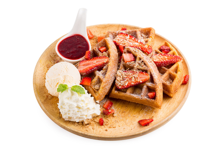 Strawberry waffles whit strawberry sauce and ice cream.