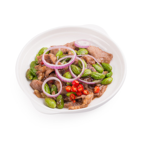 Stir Fried Pork with Shrimp Paste and bitter bean, Thai Food isolated on white background.