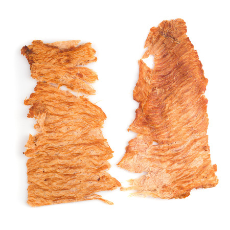 Pounded pork jerky, Dry pork pounding with meat tenderizer isolated on a white background.