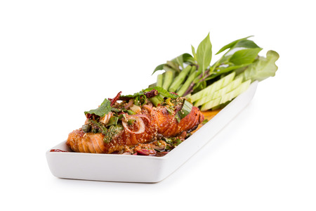 Fried Salmon steak with Spicy seafood mince sauce with mint leaf and shallot. Stock Photo