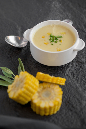 Corn soup in white cup on a table. Stock fotó