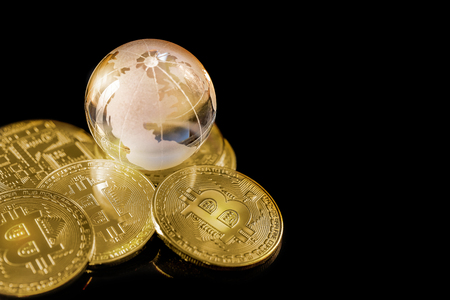 Glass globe and Bitcoin Cryptocurrency. Business concept.