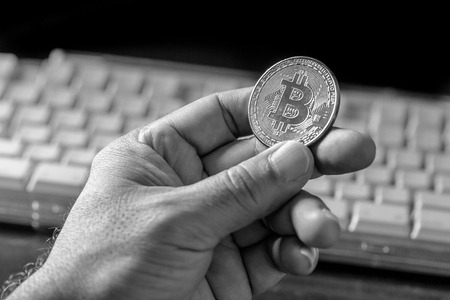 Glass globe and Bitcoin Cryptocurrency on keyboard. Business concept. Stock Photo