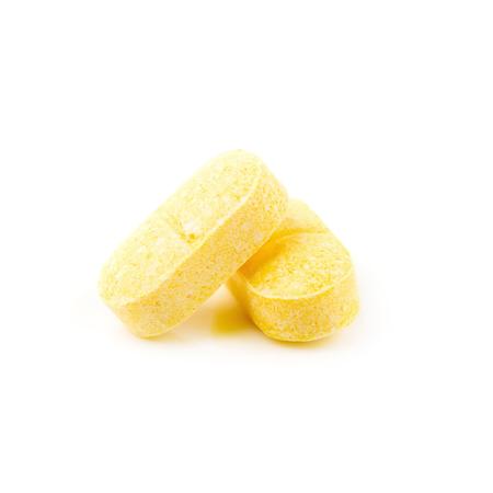 Vitamin C, yellow vitamin pills isolated on white background