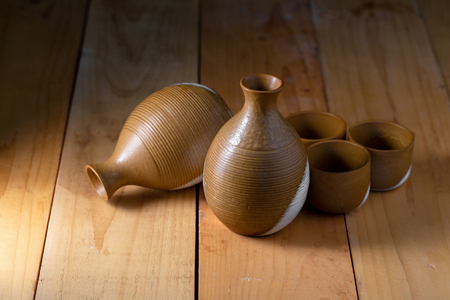 Ceramic Tableware Set on a wooden background.  Stock Photo
