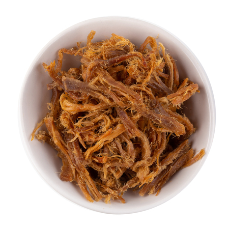 Dried shredded pork in a white bowl isolated on a white background. Standard-Bild