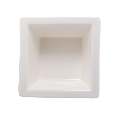 Small glazed ceramic ramekin isolated on white