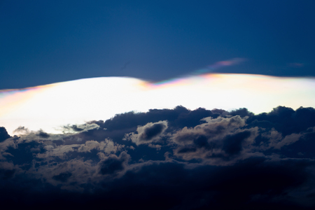 Cloud iridescence, diffraction phenomenon produce very vivid color and make cloud shine