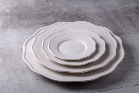 Empty blank white ceramic dish on Cement Board.