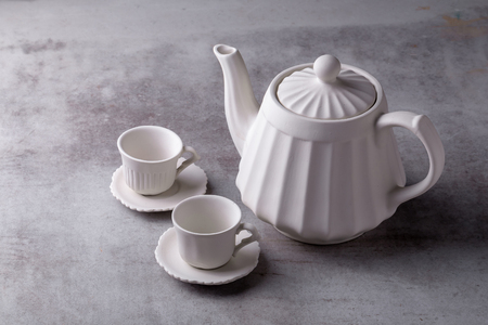 Teapot creamer, Cup and saucer on Cement Board. 스톡 콘텐츠