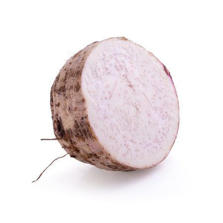 slice of taro root isolated on a white background. Stock Photo