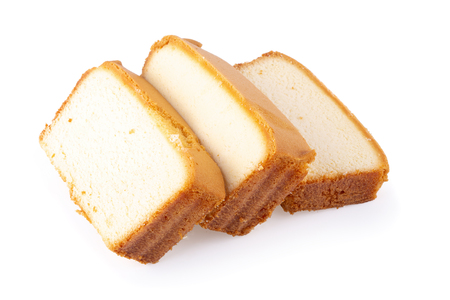 Sliced moist butter cake isolated over the white background.