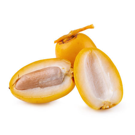 yellow raw date palm isolated over white background.