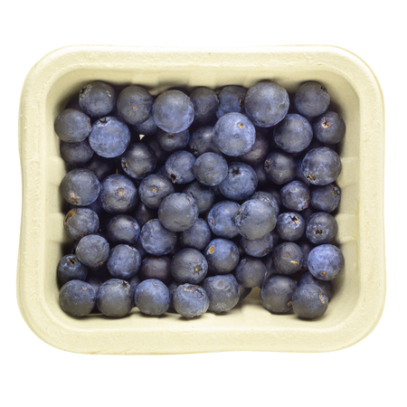 Fresh ripe blueberry in paper box isolated on a white background