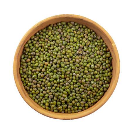 Raw mung bean or green bean in a wooden bowl isolated on white background.
