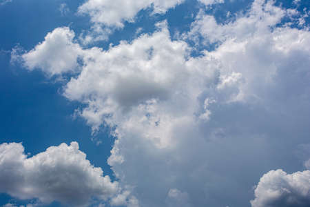 White fluffy clouds in the blue sky background 写真素材