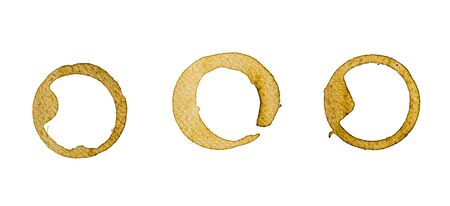 Coffee cup rings and coffee stain isolated over white background. 免版税图像