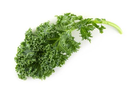 Fresh organic green kale leaves isolated on white background
