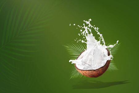 Coconut Milk Splashing isolated on Green background.