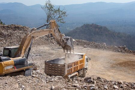 Crawler excavator, working to transport rocks at coal mines