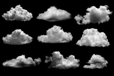 Separate white clouds on a black background have real clouds. White cloud isolated on a black background realistic cloud. white fluffy cumulus cloud isolated cutout on black background.