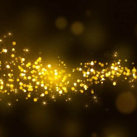 gold glittering stars on bokeh background